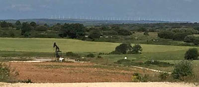 Ayoluengo Oilfeild, northern Spain, now shut in. Spain imports 99.6% of its oil needs. Wind farm in the background
